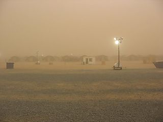 A sand storm passes through Cav Country at Camp Virginia.